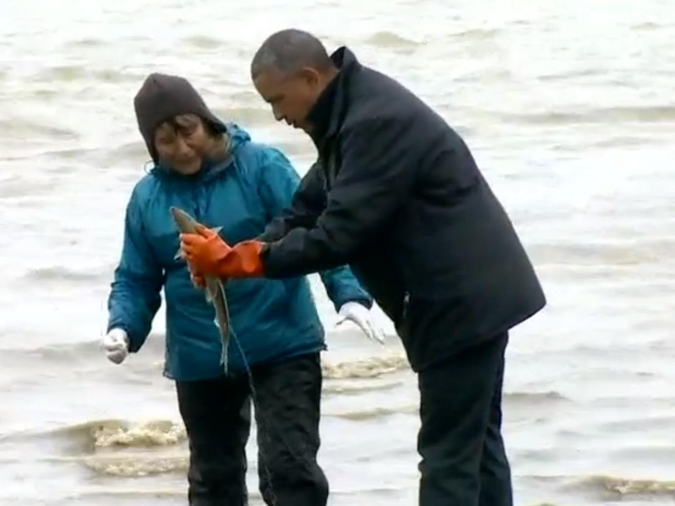 A salmon spawned on Obama's shoes during his trip to Alaska