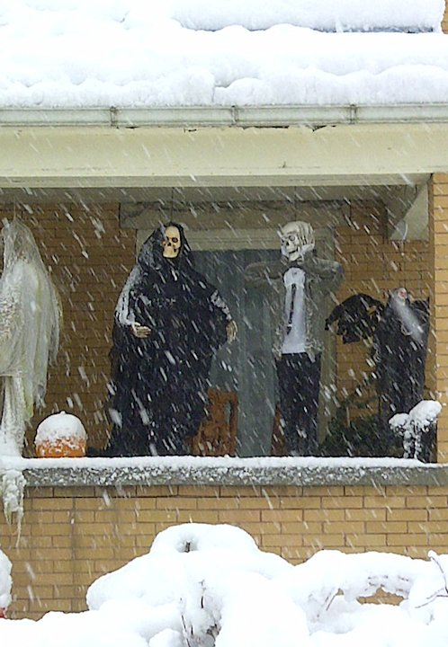 Halloween decorations are seen during a snowstorm, Tuesday, Oct. 30, 2012, in Elkins, W.Va. Superstorm Sandy buried parts of West Virginia under more than a foot of snow on Tuesday, cutting power to a