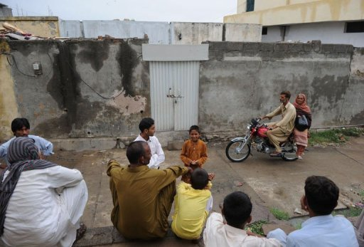 Pakistani residents gather outside the house of a Christian girl arrested on charges of blasphemy, in Islamabad. Blasphemy is an extremely sensitive subject in Pakistan, where 97 percent of the 180 million population are Muslims. Even unproven allegations of insulting Islam or desecrating the Koran can prompt anger and even violence