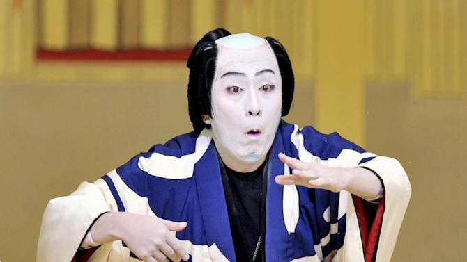 """In this photo taken Sept. 2, 2011, Kabuki actor Kanzaburo Nakamura performs in a dance drama titled """"Omatsuri"""" at the New Kabukiza theater in Osaka, Japan. Kanzaburo, who helped boost the popularity of the traditional Japanese art form, died Wednesday, Dec. 5, 2012. He was 57. (AP Photo/Kyodo News) NO ARCHIVE, ONE TIME USE ONLY, JAPAN OUT, MANDATORY CREDIT, NO LICENSING IN CHINA, FRANCE, HONG KONG, JAPAN AND SOUTH KOREA"""