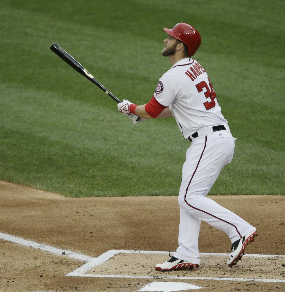 Washington Nationals Bryce Harper watches his ball clear the fence for a solo homer against Milwaukee Brewers starting pitcher Yovani Gallardo during the first inning of a baseball game at Nationals Park, Monday, July 1, 2013, in Washington. (AP Photo/Pablo Martinez Monsivais)