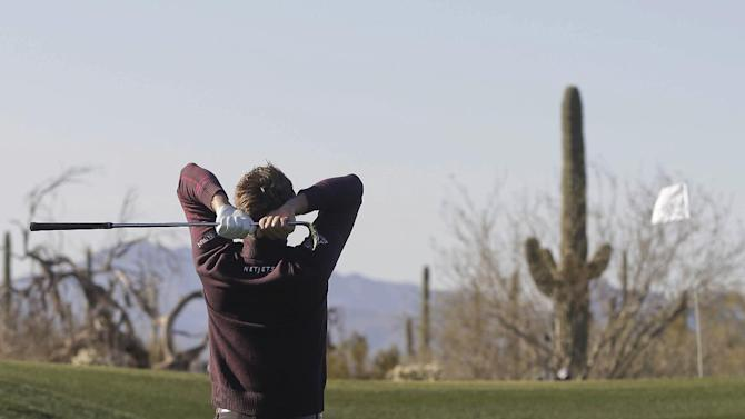 England's Ian Poulter reacts after chipping onto the eighth green in the semifinal round of play against Hunter Mahan during the Match Play Championship golf tournament, Sunday, Feb. 24, 2013, in Marana, Ariz. (AP Photo/Julie Jacobson)