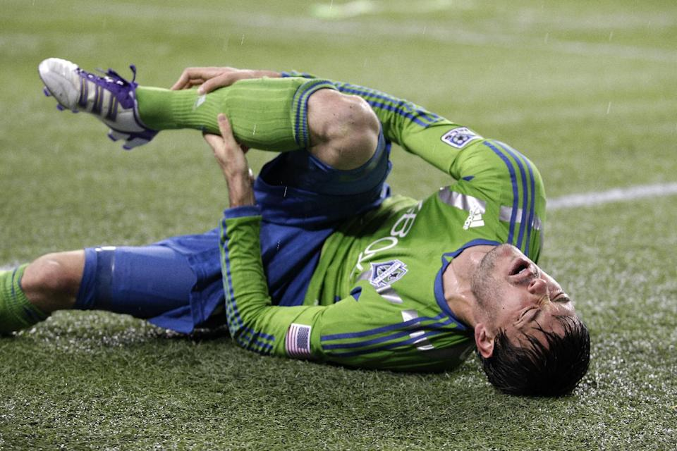 Seattle Sounders' Brad Evans lies on the ground after an injury in the first half of a MLS playoff soccer match against Real Salt Lake, Wednesday, Nov. 2, 2011, in Seattle. (AP Photo/Ted S. Warren)