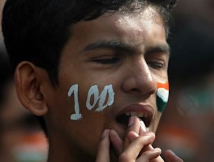 A young fan is dejected after Sachin Tendulkar was dismissed six runs short of his 100th hundred in international cricket in the Mumbai Test.