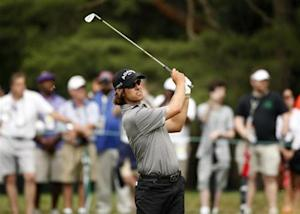 Australia's Baddeley watches his shot on the first fairway during a practice round for the 2013 U.S. Open golf championship at the Merion Golf Club in Ardmore