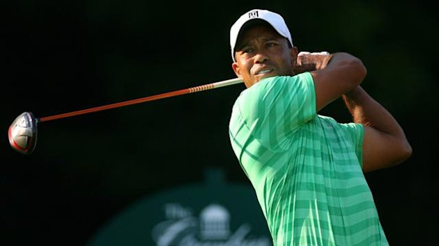 Tiger Woods hits his tee shot on the 12th hole during the second round of the Greenbrier Classic at the Old White TPC (AFP)