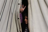 A Syrian refugee child who arrived from Damascus, gestures in a tent at the Majdal Anjar refugee camp in Bekaa Valley near the Syrian border in eastern Lebanon, September 9, 2013. REUTERS/Jamal Saidi