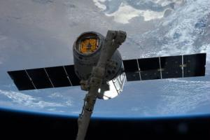 NASA picture of the SpaceX Dragon commercial cargo spacecraft grappled to Canadarm2 at the International Space Station