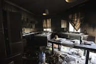 A picture shows damage inside the burnt US consulate building in Benghazi on September 13, following an attack on the building late on September 11. Libya announced Sunday the arrest of 50 suspects over the killing of the US envoy and three other Americans, blaming the Benghazi attack on foreign extremists and claiming it was pre-planned