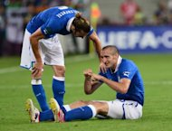 Italian defender Giorgio Chiellini (R) is injured as Italian defender Federico Balzaretti looks on during the Euro 2012 football championships match Italy vs Republic of Ireland on June 18, at the Municipal Stadium in Poznan. Chiellini was on Wednesday ruled out of Italy's Euro 2012 quarter-final against England in Kiev