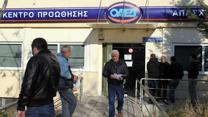 People stand outside an office of Labor Force Employment Organization (OAED) in the northern Greek port city of Thessaloniki, Greece, Thursday, Jan. 10, 2013. Unemployment has reached new highs in Greece, with October 2012 figures showing the jobless rate at 26.8 percent, a major increase from the same month in 2011. (AP Photo/Nikolas Giakoumidis)