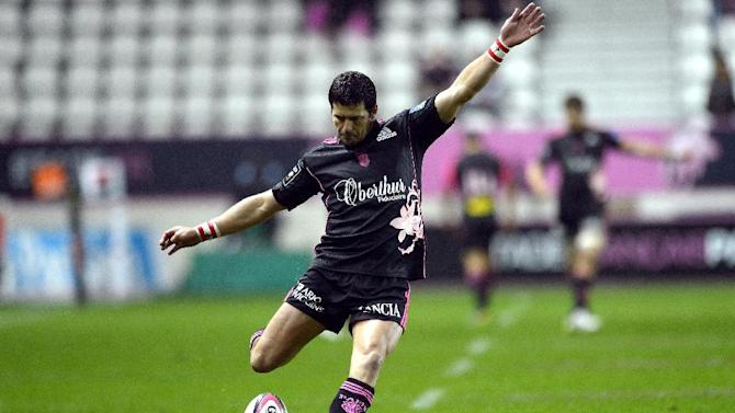 Stade Francais Paris' South African fly-half Morne Steyn kicks the ball to score a penalty during the French Top 14 rugby union match between Stade Francais Paris and Bayonne in Paris on November 2, 2013