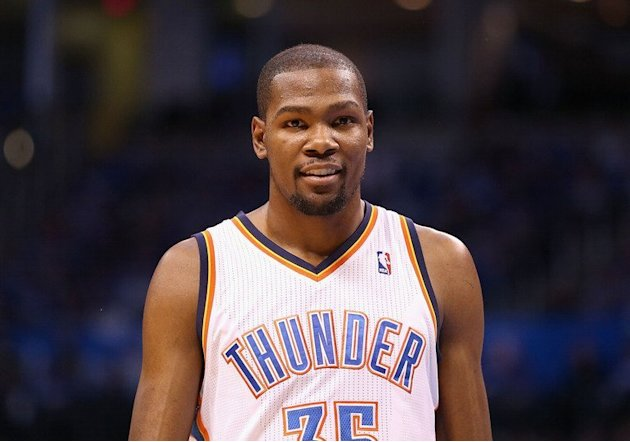 Kevin Durant of the Oklahoma City Thunder smiles as he walks up court at Chesapeake Energy Arena on April 21, 2013