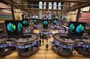 Traders work after the closing bell on the floor of the New York Stock Exchange, March 8, 2013.