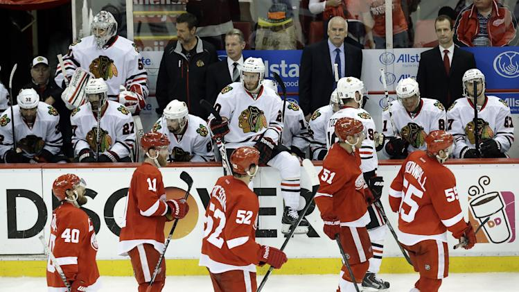 Detroit Red Wings, foreground, skate past the Chicago Blackhawks bench after Daniel Cleary's empty-net goal during the third period in Game 4 of the Western Conference semifinals in the NHL hockey Stanley Cup playoffs in Detroit, Thursday, May 23, 2013. Detroit won 2-0. (AP Photo/Paul Sancya)