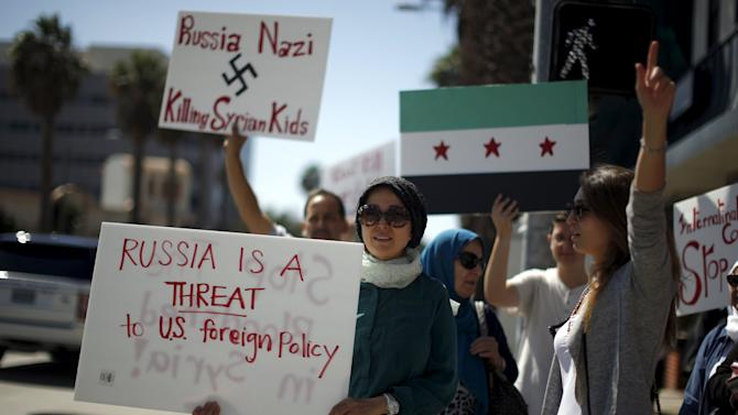 Syrian-Americans protest Russian intervention in Syria outside a Russian consular office in Santa Monica