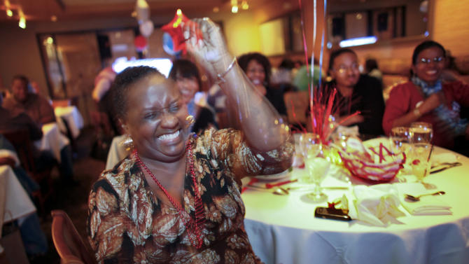 Harriet Garrett reacts while watching the first Presidential debate between Republican presidential candidate, former Massachusetts Gov. Mitt Romney, and President Barack Obama on Wednesday Oct. 3, 2012, at a restaurant in the West Oak Lane section of Philadelphia.  (AP Photo/ Joseph Kaczmarek)