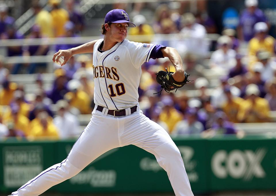 LSU pitcher Aaron Nola throws against Stony Brook in the first inning of an NCAA college baseball tournament super regional game in Baton Rouge, La., Friday, June 8, 2012. (AP Photo/Gerald Herbert)