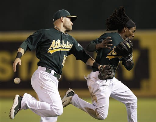 Milone leads A's past Angels 2-1