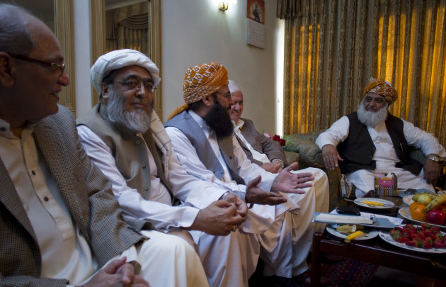 Maulana Fazal-ur-Rehman, right, chief of Pakistani religious party Jamiat Ulema-e-Islam heads a meeting of opposition leaders on Saturday, March 24, 2012 to discuss strategy for the forthcoming Parliament session scheduled to debate the terms of re-engagement with United States, in Islamabad, Pakistan. The main issue of the agenda is restoration of the NATO supply to neighboring Afghanistan, which which was suspended after NATO airstrikes that killed 24 Pakistani soldiers. (AP Photo/B.K. Bangash)