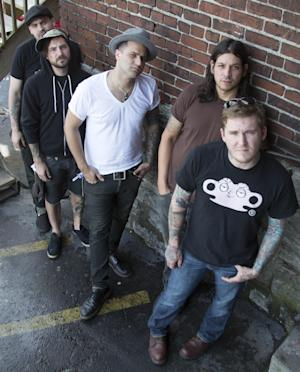 "FILE - In this July 18, 2012 file photo, from right, Brian Fallon, Benny Horowitz, Alex Levine, Alex Rosamilia, and Ian Perkins, of the musical group, The Gaslight Anthem, pose for a portrait at the Cannery Ballroom, in Nashville, Tenn. The band relocated to Nashville in February 2012 and hooked up with Grammy-winning producer, Brendan O'Brien, at Blackbird Studios, to work on their new album, ""Handwritten."" (Photo by Ed Rode/Invision/AP, File)"