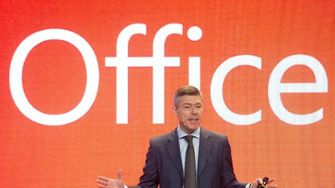 In this March 4, 2013, photo, Christian P. Illek, manager of Microsoft Germany, talks at the stand of Microsoft atCeBIT, the world's largest computer expo, in Hanover, Germany. Microsoft reports their first quarter earnings on April 18, 2013. (AP Photo/dpa, Sebastian Kahnert)