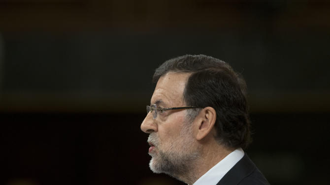 Spain's Prime Minister Mariano Rajoy speaks in the Spanish parliament in Madrid, Wednesday May 8, 2013. Rajoy appeared to explain to Parliament his conservative government's latest round of reforms and its 2013-16 stability program. Unveiling the package recently, the government said it would take two years longer than promised to cut Spain's swollen deficit in an acknowledgement that harsh austerity measures had failed to bring its finances under control.(AP Photo/Paul White)