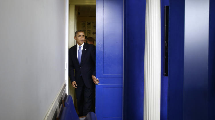 President Barack Obama enters the White House Briefing Room in Washington,  Monday, Oct. 29, 2012, to brief reporters  after returning to the White House from a campaign stop in Florida to monitor Hurricane Sandy.  (AP Photo/Jacquelyn Martin)
