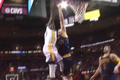 Draymond Green throws Cleveland's Timofey Mozgov on a poster