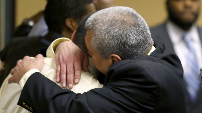 Trent Mays, 17, left, gets a hug from his father after Trent and co-defendant Ma'lik Richmond, 16, were found delinquent on rape and other charges after their trial in juvenile court in Steubenville, Ohio, Sunday, March 17, 2013. Mays and Richmond were accused of raping a 16-year-old West Virginia girl in August 2012. (AP Photo/Keith Srakocic, Pool)