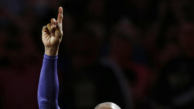 Los Angeles Lakers' Kobe Bryant waves after being introduced before an NBA basketball game between the Lakers and the Cleveland Cavaliers, Wednesday, Feb. 10, 2016, in Cleveland. (AP Photo/Tony Dejak)