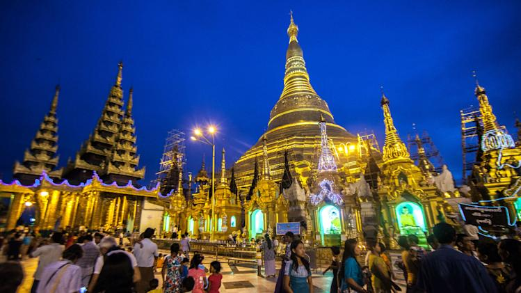 In this December 2012 photo crowds visit the Shwedagon Pagoda in Yangon, Myanmar. (AP Photo/Richard Camp)