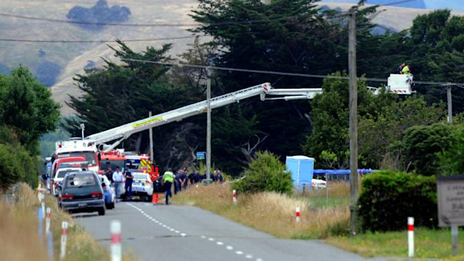 A fire department ladder truck takes police over the area where a hot air balloon crash occurred in Carterton, some 94 miles (150 kilometers) north of the capital, Wellington, New Zealand, Saturday, Jan. 7, 2012. The hot air balloon crashed and killed all 11 people aboard near a rural New Zealand town, officials said Saturday. (AP Photo/SNPA, Ross Setford) NEW ZEALAD OUT