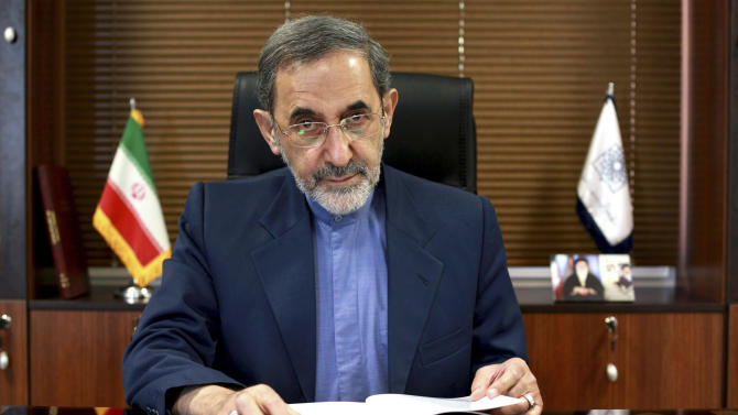 In this Sunday, Aug. 18, 2013 photo, Ali Akbar Velayati, a top adviser to Iran's supreme leader Ayatollah Ali Khamenei, poses for a photo, at the conclusion of an interview with The Associated Press at his office, in Tehran, Iran. Velayati says the election of moderate President Hasan Rouhani has provided a good opportunity for world powers to reach a deal over Iran's nuclear program. Velayati, who advises Ayatollah Ali Khamenei on key matters including the nuclear issue, tells The Associated Press that the Islamic republic will never again suspend its nuclear activities but will employ new tactics to reach out to the world to find a common language. (AP Photo/Ebrahim Noroozi)