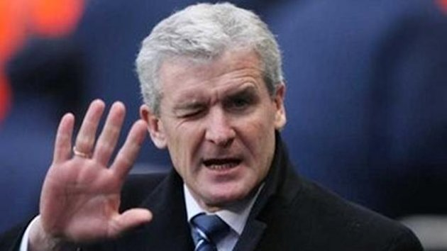 Manchester City coach Mark Hughes waves before their English Premier league soccer match at the City of Manchester Stadium in Manchester