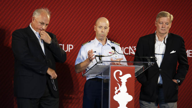 From left, America's Cup Regatta Director Iain Murray, Matt Bliven of the U.S. Coast Guard, center, and Golden Gate Yacht Club Vice Commodore Tom Ehman,right, during a news conference Tuesday, May 14, 2013 in San Francisco. Murray and Ehman announced that the America's Cup will go on as planned after the death of a sailor during a training run last week on San Francisco Bay. The officials also said they expected all four entrants to compete, including Artemis Racing. (AP Photo/Eric Risberg)