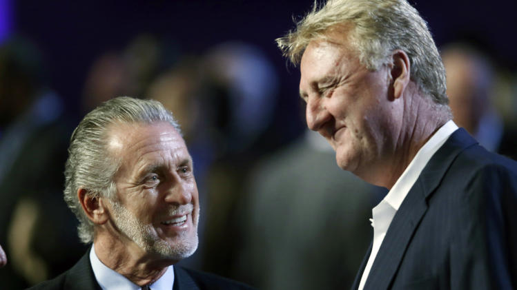 Pat Riley, left, chats with Larry Bird prior to the Naismith Memorial Basketball Hall of Fame enshrinement ceremony at Symphony Hall in Springfield, Mass. Friday, Sept. 7, 2012. (AP Photo/Elise Amendola)