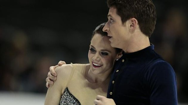 Tessa Virtue and Scott Moir of Canada skate their short program in the dance competition at the 2013 World Figure Skating Championships in London, Ontario (AFP)