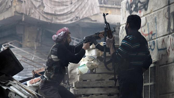 In this Saturday, Dec. 29, 2012 photo, Free Syrian Army fighters fire at enemy positions during heavy clashes with government forces, in the Salaheddine district in Aleppo, Syria. Activists say Syrian rebels have captured an oil pumping station in the north central province of Raqqa about 160 km east of Aleppo after days of fighting. (AP Photo/Abdullah Al-Yasin)