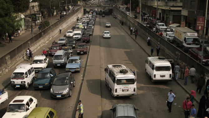 People wait in their cars in traffic in Cairo, Egypt, Wednesday, Nov. 14, 2012. Metro workers in the Egyptian capital called off a strike Wednesday after five hours that brought Cairo's already notoriously snarled traffic to a standstill after the government caved in to their key demand and sacked the chairman of the subway system. (AP Photo/Nariman El-Mofty)