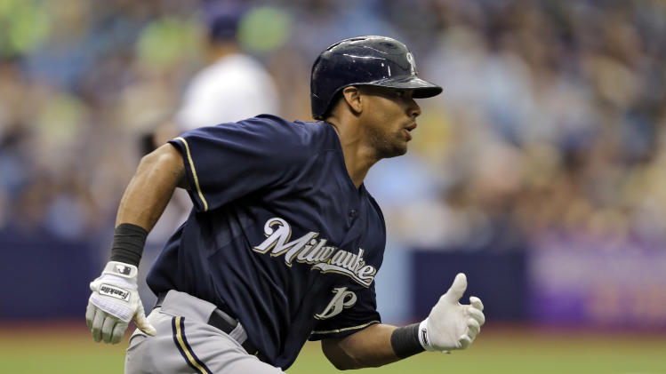 Milwaukee Brewers' Khris Davis heads for first after hitting a double off Tampa Bay Rays starting pitcher David Price during the sixth inning of an interleague baseball game Wednesday, July 30, 2014, in St. Petersburg, Fla. (AP Photo/Chris O'Meara)