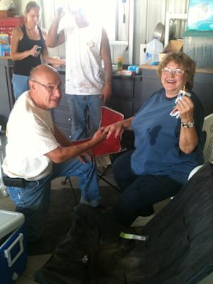 This July 8, 2013 image provided by Bethany Hansom shows Larry McCracken, left, proposing to his wife, Patti, in their garage in Yarnell, Ariz. The married couple of nearly 50 years now have Patti's wedding ring back, found by one of their daughters underneath a foot of the charred rubble that used to be their dream retirement home in the small Arizona town of Yarnell, where an erratic wildfire killed 19 elite Hotshots firefighters and destroyed more than 100 homes on June 30. (AP Photo/Courtesy of Bethany Hansom)