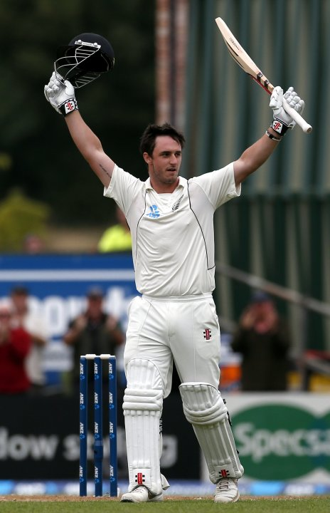 New Zealand's Rutherford celebrates making his century during the third day of the first test against England at the University Oval in Dunedin