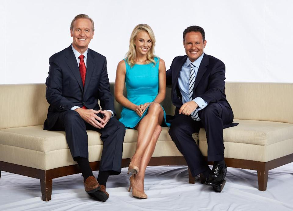 "This Aug. 2013 photo released by FOX News shows, from left, Steve Doocy, Elisabeth Hasselbeck and Brian Kilmeade in New York. Hasselbeck debuts as Doocy and Kilmeade's new partner on ""Fox & Friends"" Monday, Sept 16, 2013. (AP Photo/FOX News)"