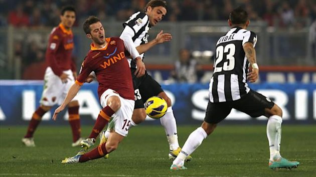 AS Roma's Miralem Pjanic (L) challenges Juventus' Alessandro Matri (C) during their Italian Serie A match at the Olympic stadium in Rome February 16, 2013 (Reuters)