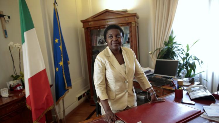Italian Minister for Integration Cecile Kyenge stands at her desk before an interview with Reuters in her office in Rome