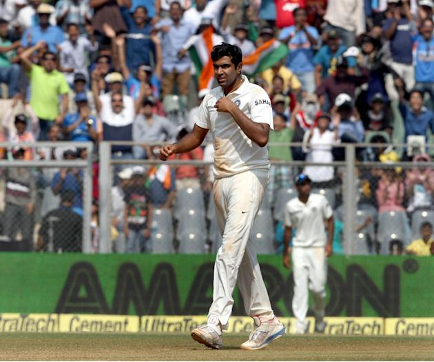 Indian cricketer Ravichandran Ashwin celebrates fall of a wicket during the 3rd day of the 2nd Test Match between India and West Indies at Wankhede Stadium in Mumbai on Nov.16, 2013. (Photo: IANS)
