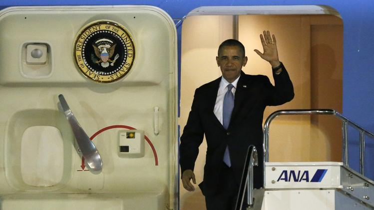 U.S. President Obama steps out from Air Force One as he arrives at Haneda International Airport in Tokyo