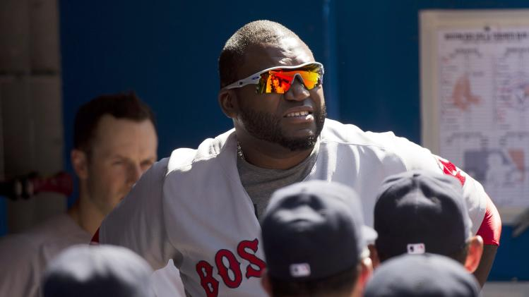 Boston Red Sox's David Ortiz, top, leavesa baseball game after injuring himself against the Toronto Blue Jays during ninth-inning action in Toronto, Thursday, July 24, 2014. (AP Photo/The Canadian Press, Nathan Denette)