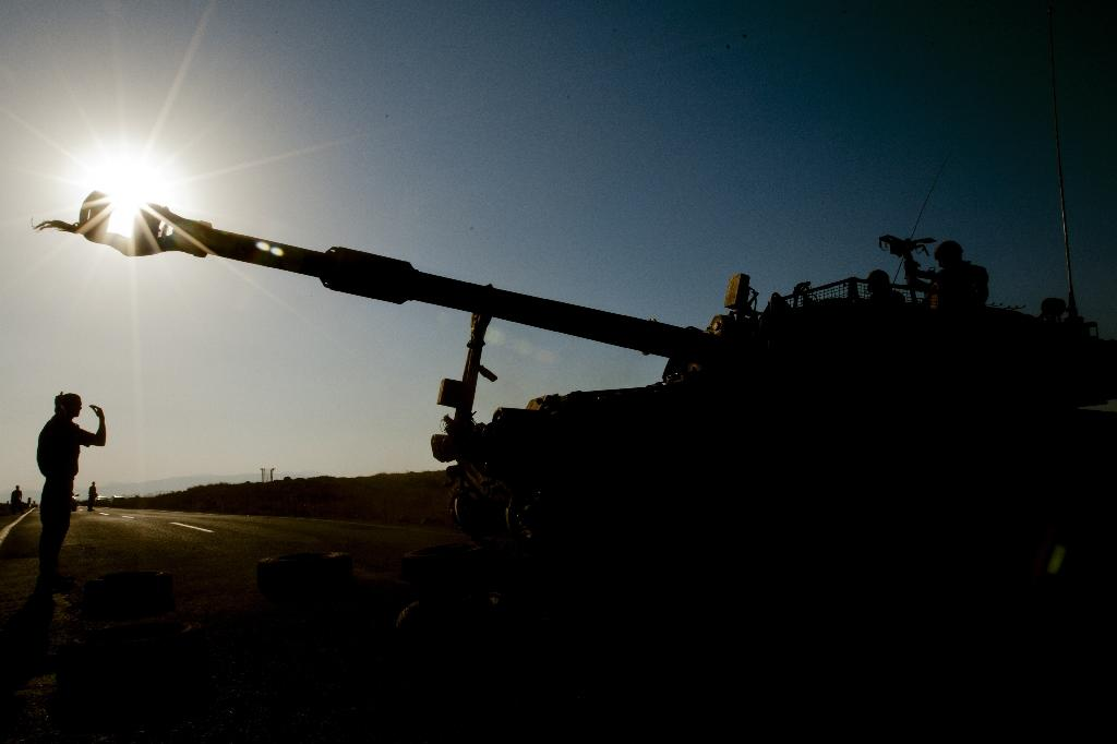Israel targets Syria army posts after rockets hit Golan